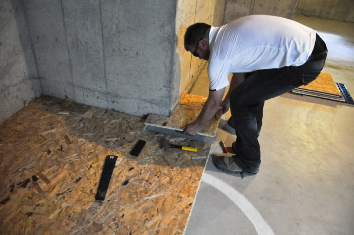 The basement project installing dricore subfloor suburble for What can i do to my concrete floor